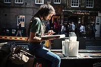 Artist draws busy street in Edinburgh, Scotland. Copyright 2019 Reid McNally.
