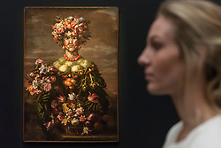 "© Licensed to London News Pictures. 01/12/2017. London, UK.  A staff member views one from ""The Four Seasons: Four Anthromophorphic Figures"", series, Rome 1608, After 1673, attributed to Giovanni Stanchi, (Est. GBP250-350k).  Preview of ""Masters of Light"", Sotheby's Old Masters Evening Sale which will take place on 6 December at Sotheby's, New Bond Street. Photo credit: Stephen Chung/LNP"