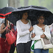 COLUMBIA, MD - May 11th, 2013 - Concert goers stand in the rain at the 2013 Sweetlife Food and Music Festival at Merriweather Post Pavilion in Columbia, MD. Despite plentiful sun early in the day, a powerful storm blew through the venue in the early evening, soaking everything outside the pavilion. (Photo by Kyle Gustafson / For The Washington Post)