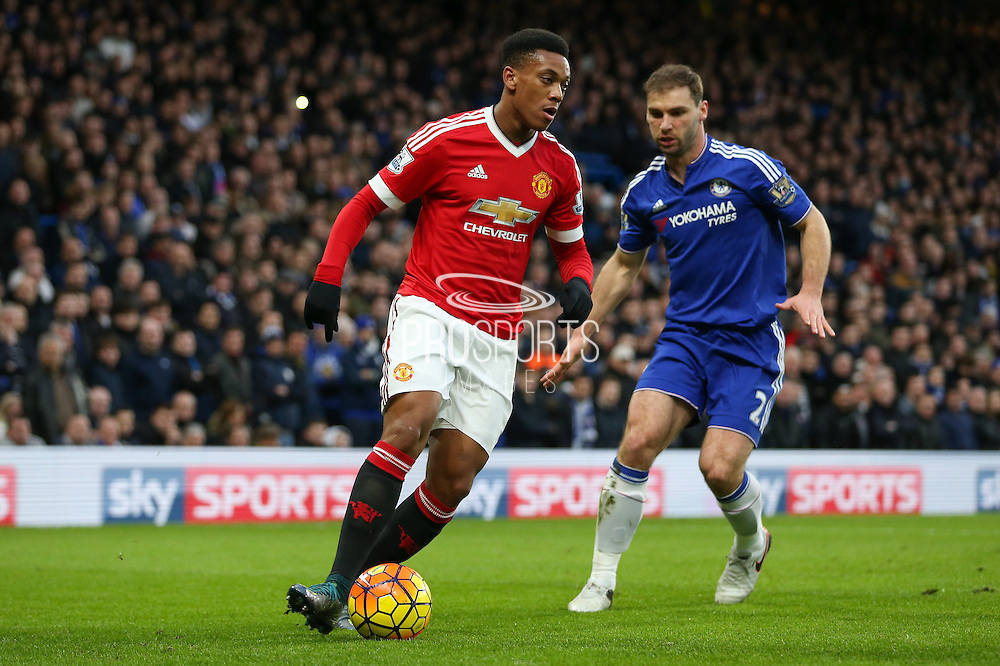 Anthony Martial of Manchester United and Chelsea's Branislav Ivanovic during the Barclays Premier League match between Chelsea and Manchester United at Stamford Bridge, London, England on 7 February 2016. Photo by Ellie Hoad.