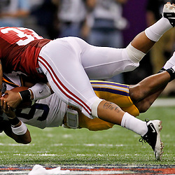 Jan 9, 2012; New Orleans, LA, USA; LSU Tigers quarterback Jordan Jefferson (9) is tackled by Alabama Crimson Tide linebacker Trey Depriest (33) during the second half of the 2012 BCS National Championship game at the Mercedes-Benz Superdome.  Mandatory Credit: Derick E. Hingle-USA TODAY SPORTS