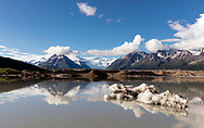 An iceberg in the melt water of the Kennicott and Root Glaciers near McCarthy in Wrangell-St. Elias National Park in Southcentral Alaska. Evening. Spring.