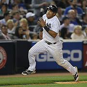 Yangervis Solarte, New York Yankees, scores in the sixth inning during the New York Yankees V New York Mets, Subway Series game at Yankee Stadium, The Bronx, New York. 12th May 2014. Photo Tim Clayton