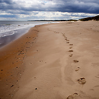 Footprints in the Sand at Druridge Bay near Amble by the Sea on the Northumberland Coast England