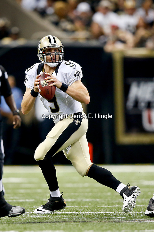 Sep 22, 2013; New Orleans, LA, USA; New Orleans Saints quarterback Drew Brees (9) against the Arizona Cardinals during a game at Mercedes-Benz Superdome. The Saints defeated the Cardinals 31-7. Mandatory Credit: Derick E. Hingle-USA TODAY Sports