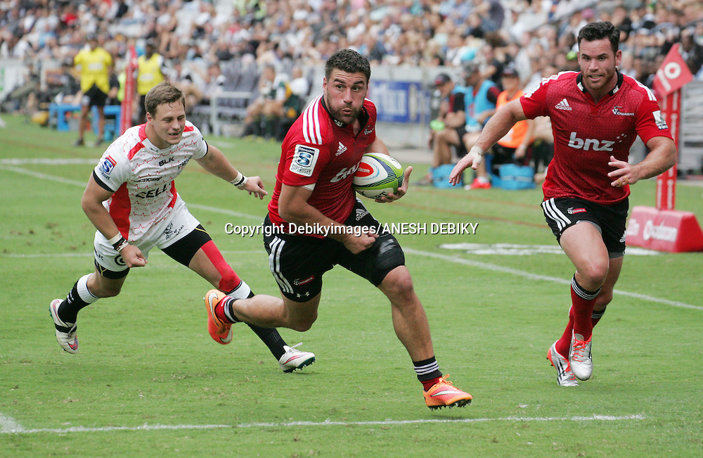 Kieron Fonotia of the Crusaders beats SP Marais of the Sharks  during the SuperXV rugby match between Sharks and Crusaders on April 4, 2015 in Durban, South Africa.<br /> Debikyimages/ANESH DEBIKY