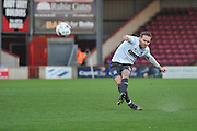 Chris Hussey (3) of Bury kicks forward  during the Sky Bet League 1 match between Scunthorpe United and Bury at Glanford Park, Scunthorpe, England on 19 April 2016. Photo by Ian Lyall.