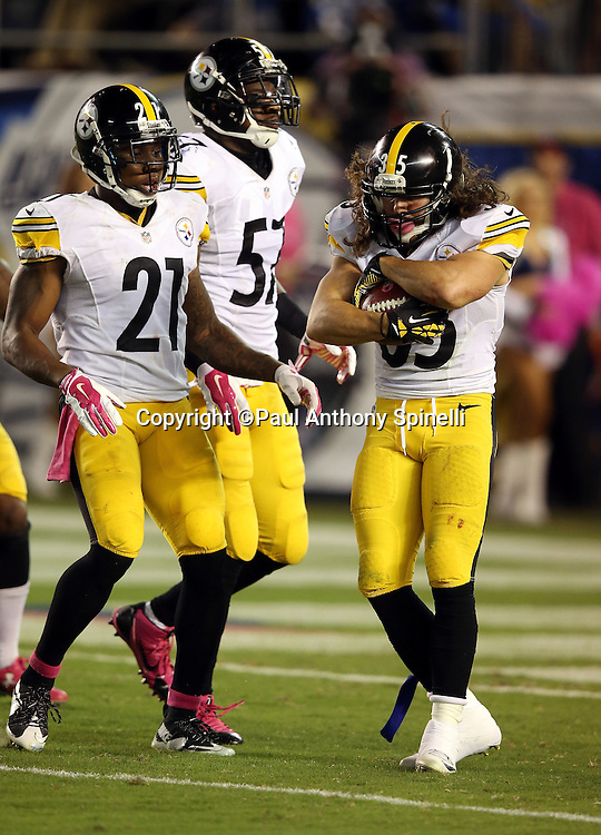 Teammates look on as Pittsburgh Steelers defensive back Ross Ventrone (35) downs a punt at the San Diego Chargers 4 yard line in the third quarter during the 2015 NFL week 5 regular season football game against the San Diego Chargers on Monday, Oct. 12, 2015 in San Diego. The Steelers won the game 24-20. (©Paul Anthony Spinelli)
