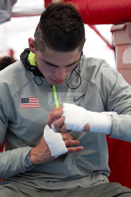 Jose Ramirez of the USA Olympic boxing team wraps his hand during a workout session at the SCORE Training Facility on July 26, 2012 in London, England. (Jed Jacobsohn/for The New York Times)....