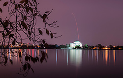The Northrop Grumman Antares rocket, with Cygnus resupply spacecraft onboard, is seen above the Thomas Jefferson Memorial in this long exposure, as it launches from Pad-0A, Saturday, Nov. 17, 2018 at NASA's Wallops Flight Facility in Virginia. Northrop Grumman's 10th contracted cargo resupply mission for NASA to the International Space Station will deliver about 7,400 pounds of science and research, crew supplies and vehicle hardware to the orbital laboratory and its crew. Photo Credit: (NASA/Aubrey Gemignani)