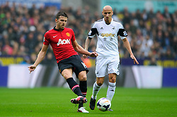 Man Utd Midfielder Michael Carrick (ENG) passes during the first half of the match - Photo mandatory by-line: Rogan Thomson/JMP - Tel: Mobile: 07966 386802 17/08/2013 - SPORT - FOOTBALL - Liberty Stadium, Swansea -  Swansea City V Manchester United - Barclays Premier League - First round of the 2013/14 season and the first league match for new Man Utd manager David Moyes.