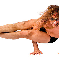Yogi Marc Linton performs yoga poses on black backdrop