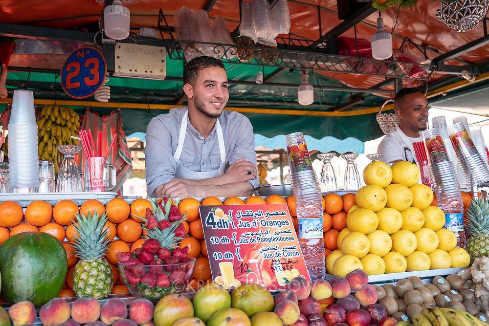 Young men vendors at a juice stand in Jemaa el-Fnaa Square, Marrakech, Morocco.