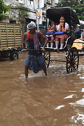 August 1, 2018 - Kolkata, India - A hand Rickshaw ride   waterlogged street after heavy rainfall on August 01,2018  in Kolkata city ,India. (Credit Image: © Debajyoti Chakraborty/NurPhoto via ZUMA Press)