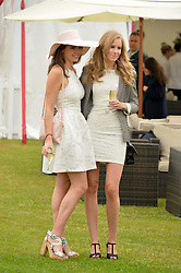 Left to right, GENEVIEVE GAUNT and ISABELLE RIEDER at the Cartier Queen's Cup Polo final at Guard's Polo Club, Smiths Lawn, Windsor Great Park, Egham, Surrey on 14th June 2015