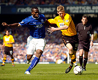 Photo. Jed Wee.<br /> Everton v Blackburn Rovers, FA Barclaycard Premiership, 24/04/2004.<br /> Blackburn's Jon Stead (R) tries to beat Everton's Joseph Yobo.