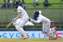 August 12, 2017 - Colombo, Sri Lanka - Indian cricketer Lokesh Rahul(L) looks on as Sri Lankan wicket keeper Niroshan Dickwella fails to collect the ball during the 1st Day's play in the 2nd Test match between Sri Lanka and India at the Pallekele International cricket stadium, Kandy, Sri Lanka on Saturday 12 August 2017. (Credit Image: © Tharaka Basnayaka/NurPhoto via ZUMA Press)