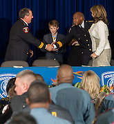 Houston ISD Chief of Police Robert Mock, left, shakes hands with retiring Chief Jimmy Dotson, right, after being sworn into office by superintendent Dr. Terry Grier, January 6, 2014, at the High School for Law Enforcement and Criminal Justice.