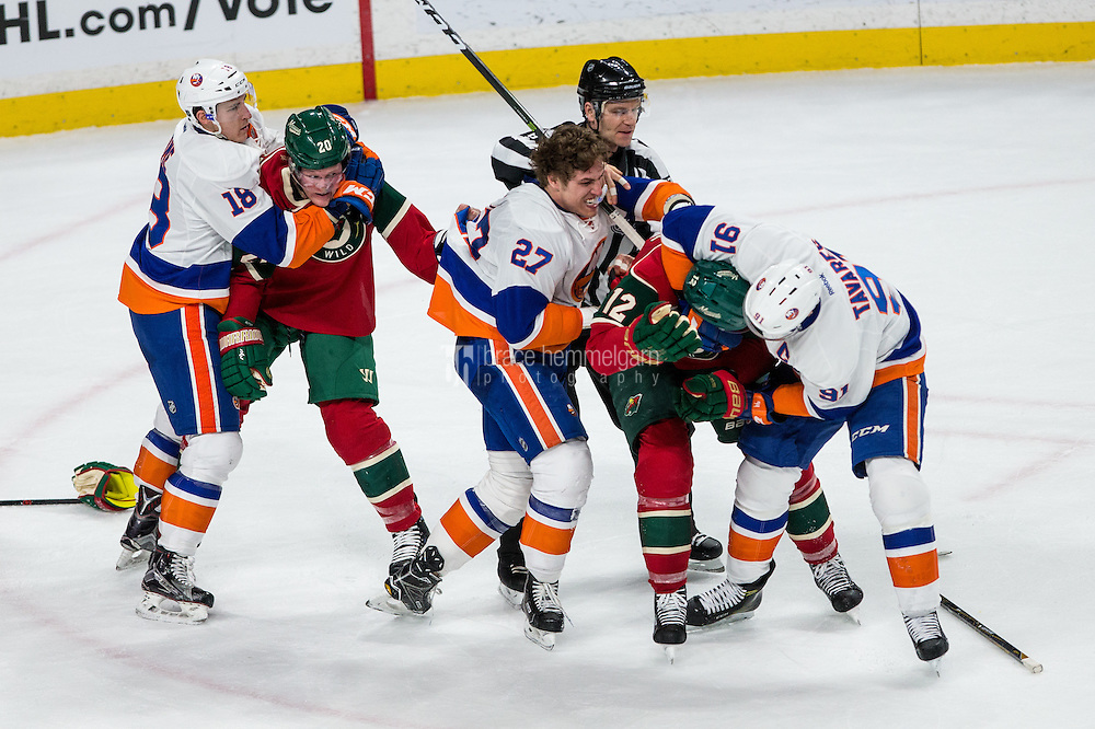 Dec 29, 2016; Saint Paul, MN, USA; New York Islanders forward John Tavares (91) and forward Anders Lee (27) grab Minnesota Wild forward Eric Staal (12) in front of defenseman Ryan Suter (20) during the third period at Xcel Energy Center. The Wild defeated the Islanders 6-4. Mandatory Credit: Brace Hemmelgarn-USA TODAY Sports