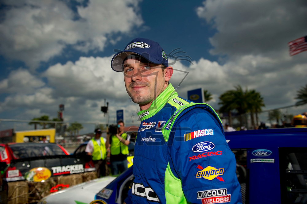Daytona Beach, FL - FEB 19, 2012: Casey Mears (13) gets out of the car during qualifying for the Daytona 500 at the Daytona International Speedway in Daytona Beach, FL.