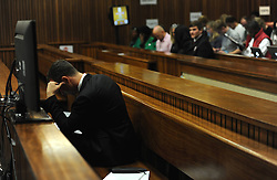 BY COURT ORDER, THIS IMAGE IS FREE TO USE.<br /> 61178308<br /> The accused Oscar Pistorius in the Pretoria High Court on March 6, 2014, in Pretoria, South Africa. Pistorius stands accused of the murder of his girlfriend, Reeva Steenkamp, on February 14, 2014. This is Pistorius official trial, the result of which will determine the paralympian athlete s fate,Thursday, 6th March 2014. Picture by  imago / i-Images<br /> UK ONLY