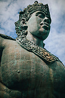 A large stone statue of Wisnu at GWK Cultural Park in Bali, Indonesia.