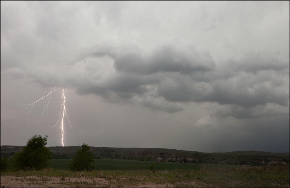 Single lightning bolt creates a dramatic scene near Lincoln, Kansas.