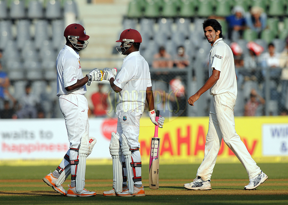 Darren Bravo of West Indies celebrate with teammate Kirk Edwards of West Indies as he hits a half century during the 1st day of the 3rd test match between India and The West Indies held at Wankhede Stadium in Mumbai, India on the 22nd November 2011..Photo by Pal Pillai/BCCI/SPORTZPICS