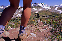 Close-up of hiker's legs, on the trail to Singing Pass, on Whistler Mountain, BC Canada