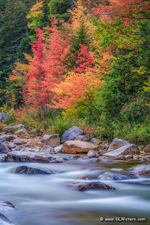 Long exposure of the Swift River in the fall along the Kancamagus Highway in the White Mountains of New Hampshire.