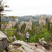 Custer State Park is a state park and wildlife reserve in the Black Hills of southwestern South Dakota. A large herd of buffalos, American Bison, roams the park.<br />  The park is South Dakota's largest and first state park, named after Lt. Colonel George Armstrong Custer.   Photography by Jose More