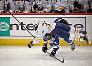 SHOT 3/28/15 8:05:41 PM - The Colorado Avalanche's Jan Hejda #8 collides with the Buffalo Sabres' Matt Ellis #37 along the boards during their regular season NHL game at the Pepsi Center in Denver, Co. The Avalanche won the game 5-3. (Photo by Marc Piscotty / © 2015)
