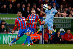 Jesus Navas of Manchester City clears from Jason Puncheon of Crystal Palace - Photo mandatory by-line: Rogan Thomson/JMP - 07966 386802 - 06/04/2015 - SPORT - FOOTBALL - London, England - Selhurst Park - Crystal Palace v Manchester City - Barclays Premier League.