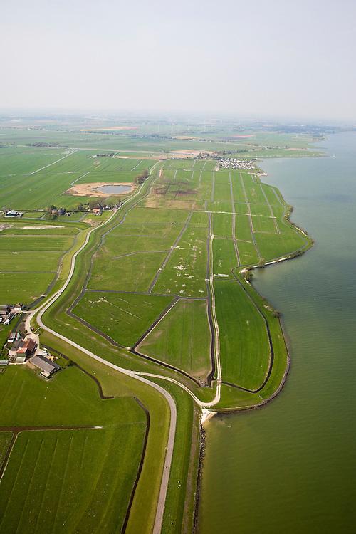"""Nederland, Noord-Holland, Gemeente Zeevang, 28-04-2010; Polder de Oosterkoog, ingepolderd buitendijks land, vermoedelijk rond 1418. Buitendijks land of voorland helpt de zeedijk te beschermen. De restanten van een dijkdoorbraak, de  'Koogbraak' (midden), zijn dan ook van eerdere datum..Polder the Eastern Koog, reclaimed land outside the dikes, probably from around 1418. 'Outside land'  helps to protect the dike. The remains of a dike breach, the """"Koog Fallows' (center), are therefore of earlier date..luchtfoto (toeslag), aerial photo (additional fee required).foto/photo Siebe Swart"""