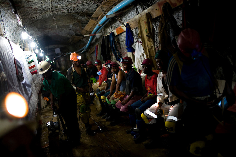 Gold miners pray underground before beginning a shift at the Great Noligwa Mine, run by Anglo Gold.  This mine has a dust reduction system in place in hopes of lowering the rate of silicosis.  Doctors have thus far found that while silica dust is reducing, silicosis remains constant, possibly owing to the latency of the disease. South African Gold miners are particularly vulnerable to contracting TB because of the small, poorly ventilated work and living conditions, high rates of HIV and high rates of silicosis, a lung disease often found in miners that increases the chance of having active TB.