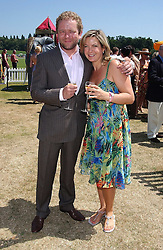 Impressionist JOHN CULSHAW and tv presenter PENNY SMITH at the Veuve Clicquot sponsored Gold Cup Final or the British Open Polo Championship held at Cowdray Park, West Sussex on 17th July 2005.<br />