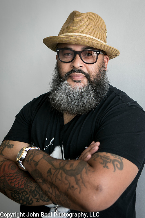 """Portraits of Reggie """"Hollywood the Barber"""" Blagmon, in his studio space in Laurel, MD, on Monday, June 18, 2018. He's been a barber for 29 years, inspired by his father's style. His used to be a singer in the '70's for R&B groups, The Stridels and later, The Choice Four who had a few hits and once performed on Soul Train. John Boal Photography"""