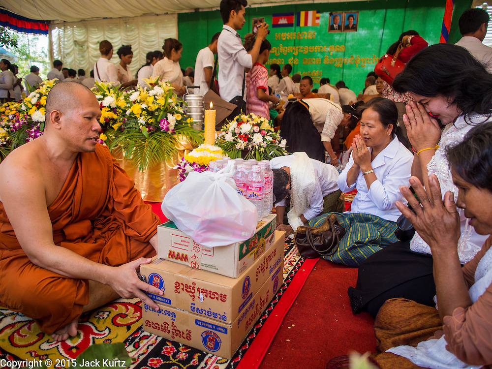15 MARCH 2015 - SIEM REAP, SIEM REAP, CAMBODIA: Buddhist monks receive alms from lay people at the annual mass merit making at Wat Bo in Siem Reap. More than 1,200 Buddhist monks, from across Siem Reap province, received alms from Buddhist lay people during the morning long ceremony. Wat Bo was originally built to be a the temple for Siamese (Thai) troops when Siem Reap and western Cambodia were controlled by Siam (Thailand). Now Wat Bo is one of the most important temples in Siem Reap.      PHOTO BY JACK KURTZ