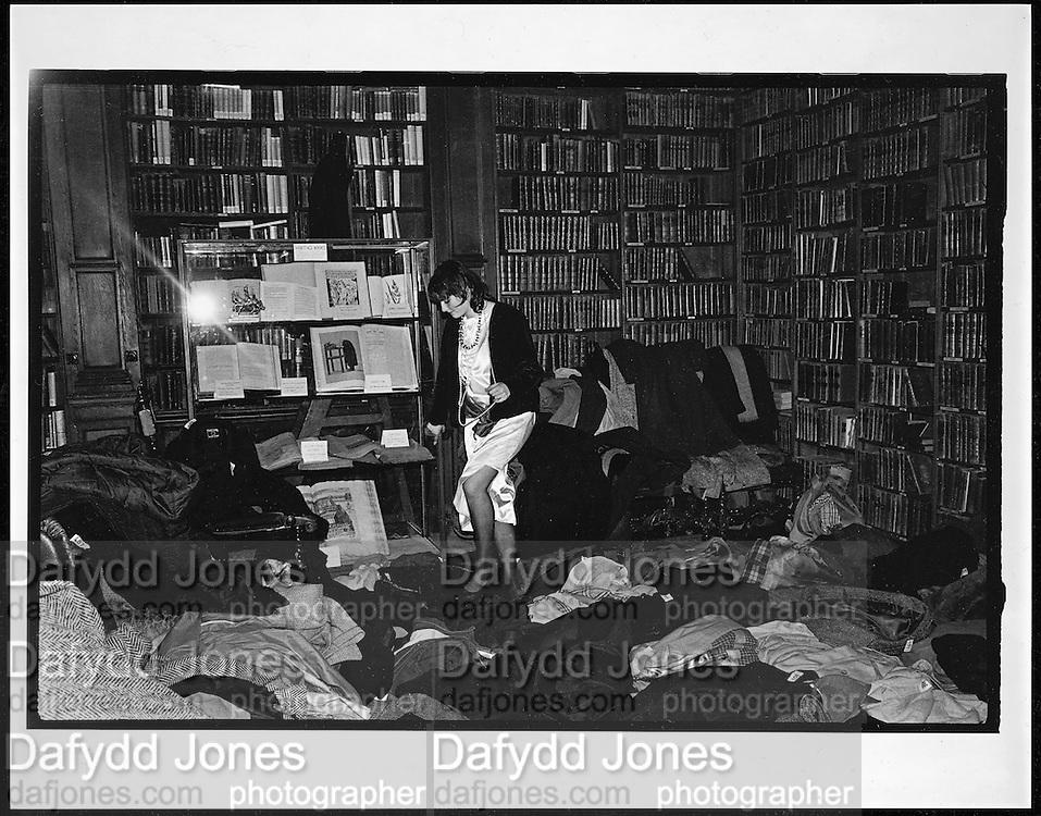 Georgia Metcalf ( now Georgia Coleridge ) looking for her coat at the Valentino Ball. Oxford Union. 16 February 1984. Film 8561f25