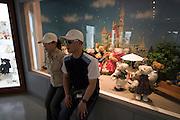 "Jeju Island. Jungmun Tourist Complex. Teddybear Museum. Toursists taking souvenir photos with bears. ""Disneyland"" display."