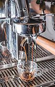 Espresso coffee machine closeup while brewing a cup of coffee