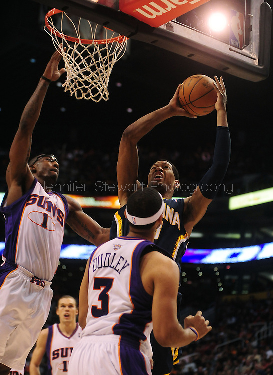 Mar. 6 2010; Phoenix, AZ, USA;  Indiana Pacers forward Danny Granger (33) puts up the ball against Phoenix Suns forward Amare Stoudemire (1) in the first half at the US Airways Center.  Mandatory Credit: Jennifer Stewart-US PRESSWIRE.