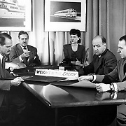 Studebaker's Design Department staff meets in the late 1940s.  L-R: A. Baker Barnhart, Raymond Loewy, Dorothy (last name unknown), Gordon Buehrig, and Robert Bourke.