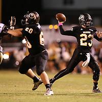 Adam Robison | BUY AT PHOTOS.DJOURNAL.COM<br /> Pontotoc quarterback Trey Shelton passes to his receiver down field