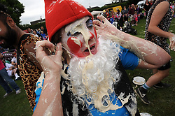 © Licensed to London News Pictures. 01/06/2013<br /> World Custard Pie Championships at Coxheath Village Hall Playing Fields in Kent (today 01.06.2013)<br /> The annual event of Custard Pie throwing is done in fancy dress with 4 people in each team. Judges award 6 points for face strikes,3 points for near miss from shoulder height and 1 point for hitting any other part of the body.<br /> A gnome gets it in the face..<br /> Photo credit :Grant Falvey/LNP