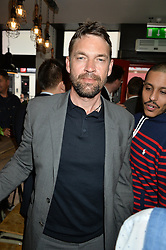 DOUGRAY SCOTT at a party to celebrate the launch of Top Dog at 48 Frith Street, Soho, London on 27th May 2015