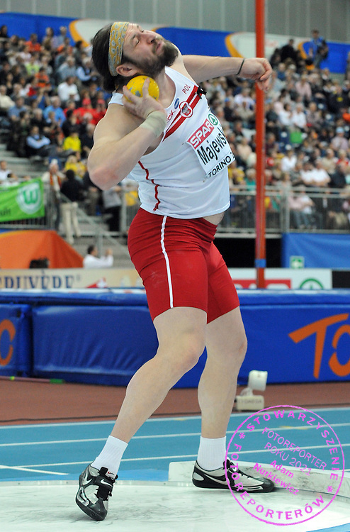TOMASZ MAJEWSKI (POLAND) COMPETES IN SHOT PUT MEN AT OVAL LINGOTTO HALL DURING EUROPEAN ATHLETICS INDOOR CHAMPIONSHIPS TORINO 2009...TORINO , ITALY , MARCH 08, 2009..( PHOTO BY ADAM NURKIEWICZ / MEDIASPORT ).