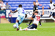 Bolton Wanderers forward Eddie Brown tackle the opponent during the EFL Sky Bet League 1 match between Bolton Wanderers and Coventry City at the University of  Bolton Stadium, Bolton, England on 10 August 2019.