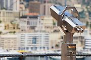 MONACO, MONACO - JUNE 17, 2015: Exterior of the coin operated binocular at the viewpoint with the urban panorama at the background in Monaco.
