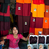 Myanmar (Burma). Yangon. Robes for Buddhist monks on sale in the market.